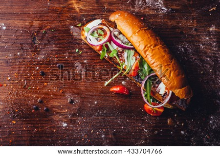 pork knuckle or ham hock sandwich on a wooden table  - stock photo