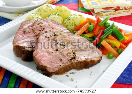 Pork meat with vegetables - stock photo