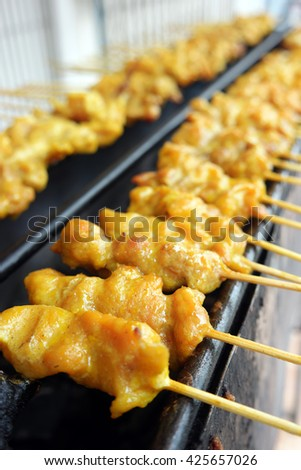 Pork of Chicken Satay grilling on the satay charcoal stove grill. - stock photo