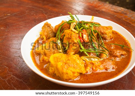 Pork Ribs Curry with Chilies and Kaffir Lime Leaves - stock photo