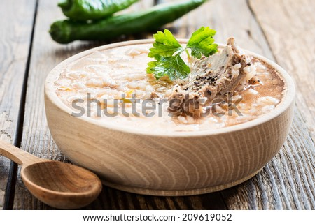 Pork ribs soup with rice in wooden bowl