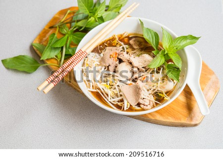 Pork rice noodle soup with meat ball and vegetable - stock photo