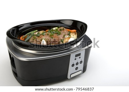 Pork Roast and Vegetables in a Slow Cooker - stock photo