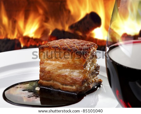 Pork roast in the wood oven - stock photo