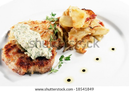 Pork Schnitzel with Fried Potato and Sauce Tartar. Isolated on White Background
