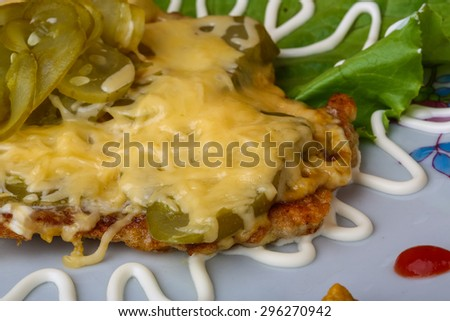 Pork schnitzel with mustard and cheese sauce - stock photo