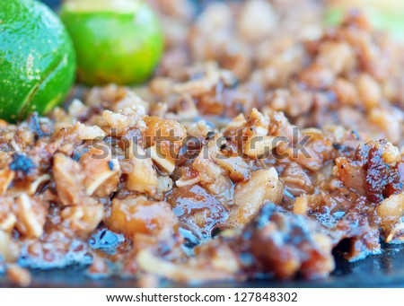 pork sisig made of pig ear,liver,meat and seasoned with vinegar,salt and pepper - stock photo