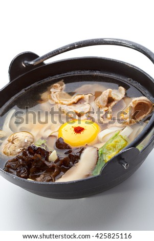 Pork Soup with Mushrooms (Shitake), Chinese Cabbage, Noodles (Udon), Red Pepper and Egg Yolk