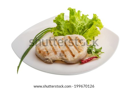 Pork steak grilled with salad and onion