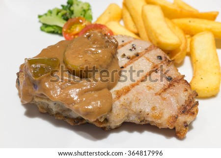 Pork steak serve with apple sauce for dinner.