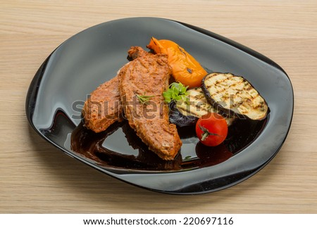 Pork steak with grilled vegetables