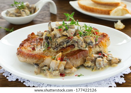 Pork steak with mushroom sauce and cream. - stock photo