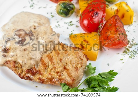 pork steak with mushroom sauce and grilled vegetables