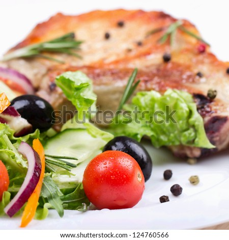 Pork steak with salad - stock photo