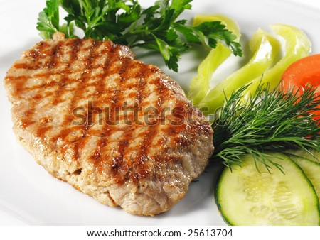 Pork Steak with Vegetables. Isolated on White Background - stock photo