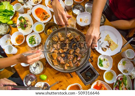 "pork strips sizzling on a grill "" Korean BBQ"