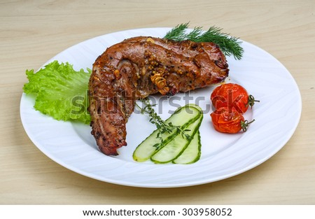 Pork tenderlion grilled with herbs and tomato