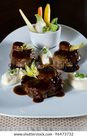 Pork tenderloin medallions with creamed potatoes - stock photo
