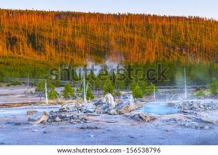 Porkchop Geyser at Sunset - Norris Basin Yellowstone - stock photo