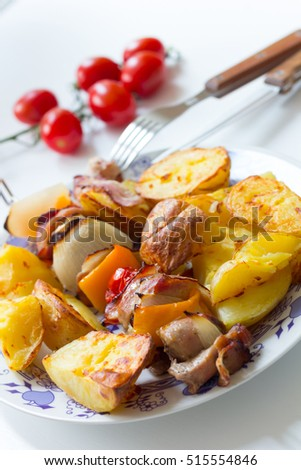 Porky skewer with potato wedges
