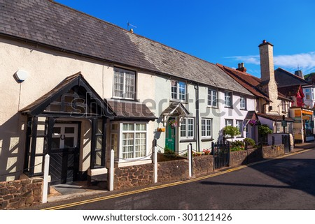 PORLOCK, ENGLAND - JULY 09, 2015: street view of Porlock with unidentified people. Porlock is a coastal village and civil parish in Somerset, situated in a deep hollow below Exmoor.