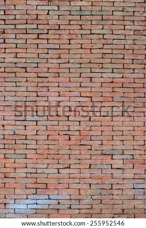 Porous red bricklaying without filling with cement, background. Vertical image - stock photo