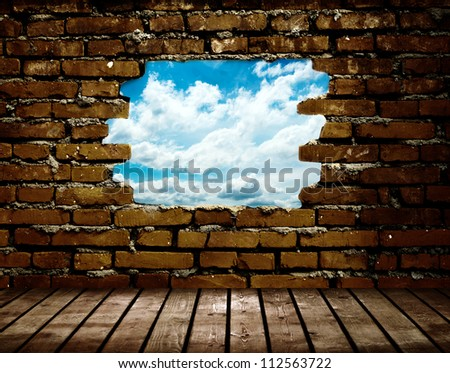 porous wall to see the blue sky - stock photo