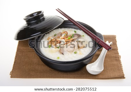 Porridge, abalone & chicken Porridge (congee) served in claypot