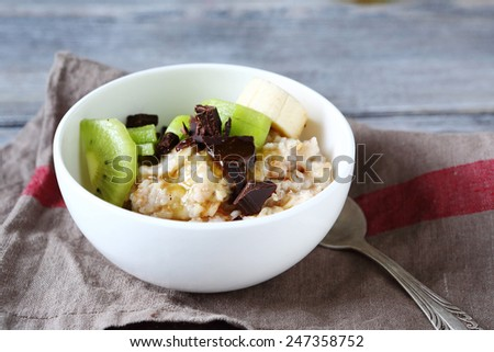 Porridge of oatmeal and fruit, food - stock photo
