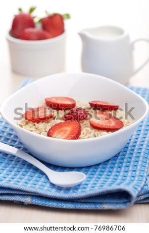 porridge with fresh strawberry - stock photo