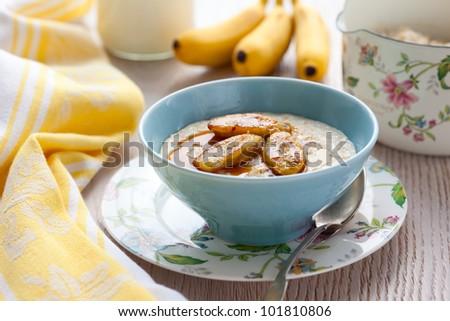 Porridge with honey and caramelised  bananas - stock photo