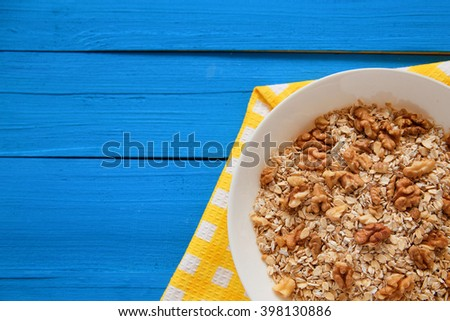 Porridge with nuts. Oatmeal with  with walnuts. Oatmeal in a bowl. Spoon, a plate of porridge. Diet menu. Weight loss, weight loss, diet concept. Top view point. - stock photo