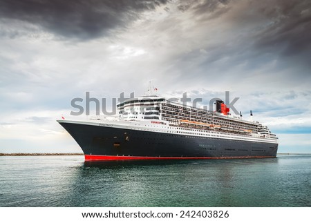 Port Adelaide, South Australia, March 10, 2014:  RMS Queen Mary 2 is leaving Outer Harbour and heading to Melbourne - stock photo
