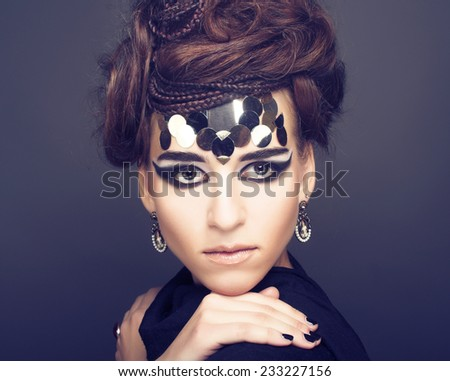 Port?ait of young stylish woman with creative visage. - stock photo
