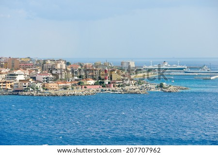 port and lighthouse in Villa San Giovanni of city Reggio di Calabria from Strait of Messina, Italy in summer day - stock photo
