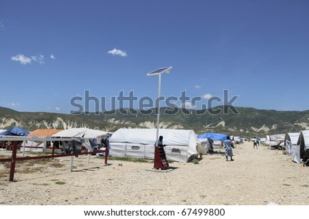 PORT-AU-PRINCE - AUGUST 30:  A solar system in one of the tent city , in Port-Au-Prince, Haiti on August 30, 2010. - stock photo