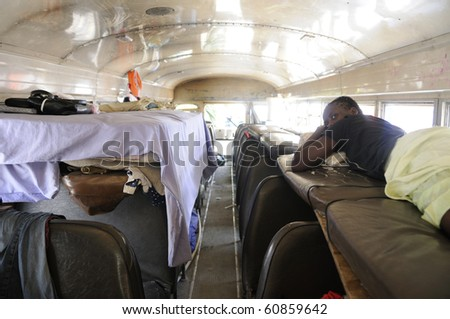 PORT-AU-PRINCE - AUGUST 28:   An Haitian girl along with her belongings inside a bus,in Port-Au-Prince, Haiti on August 28, 2010.