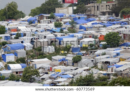 PORT-AU-PRINCE - AUGUST 28:  An huge amount of area of  the capital of Haiti is occupied by Tents on August 28, 2010 in Port-Au-Prince, Haiti - stock photo