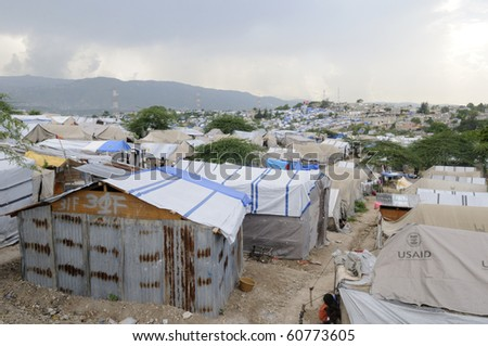 PORT-AU-PRINCE - AUGUST 28:   Damaged Tents are also reconstructed with Tins instead of plastic as plastic tents are expensive,  on August 28, 2010 in Port-Au-Prince, Haiti - stock photo