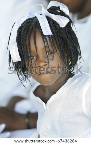 PORT-AU-PRINCE - SEPTEMBER 1:  An unidentified small Haitian girl looking with grief during her 6 month old brother's funeral who was burnt alive,  in Port-Au-Prince, Haiti on September 1, 2010. - stock photo