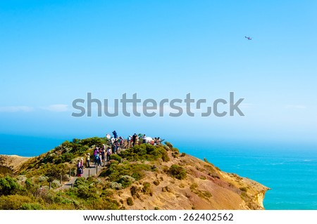 Port Campbell National Park, Victoria, Australia - February 19, 2015: Tourists visiting the Twelve Apostles, a famous collection of limestone stacks off the shore of the Port Campbell National Park - stock photo
