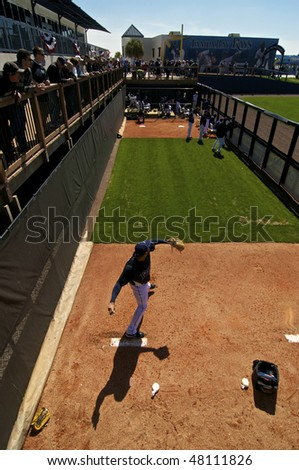 PORT CHARLOTTE, FLORIDA - MARCH 4: Joaquin Benoit of the Tampa Bay Rays warms up in the bullpen during a game against the Baltimore Orioles on March 4, 2010 in Port Charlotte, Florida - stock photo