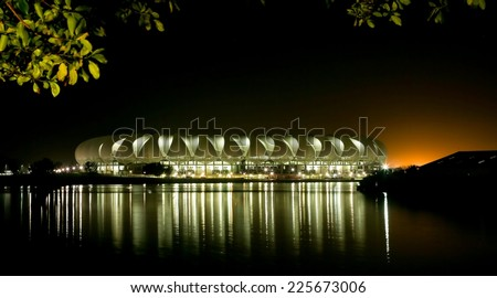 Port Elizabeth Soccer Stadium at Night with lights reflecting on the water