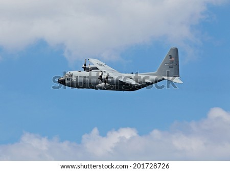 PORT-EN-BESSIN, FRANCE - JUNE 5: A US Hercules gunship flies along the D-Day landing beaches in preparation for the 70th D-Day anniversary celebratory flypast on June 5, 2014 in Port-en-Bessin