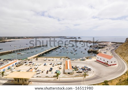 Port facility full of boats under cloudscape - stock photo