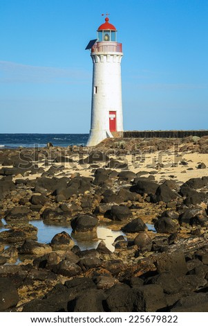 Port Fairy lighthouse (c1859) on Griffiths Island in Victoria, Australia. - stock photo
