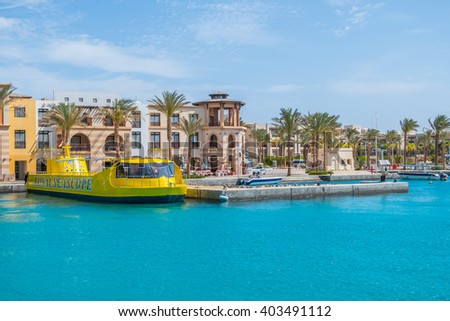 PORT GHALIB, EGYPT, MARCH 30, 2016: Touristic boats moor in port - stock photo