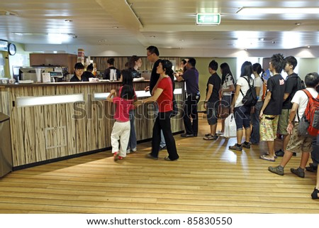 PORT KLANG, MALAYSIA - OCTOBER 1: Visitors at the MV Logos Hope cafe on October 1, 2011 in Port Klang, Malaysia. The 132.5m long ship host the world's biggest floating book fair with 5000 book titles. - stock photo