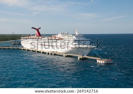 PORT OF FREEPORT GRAND BAHAMAS ISLAND - JAN., 18, 2015: Carnival Elation Cruise ship docked in Freeport Grand Bahamas at sunset - stock photo