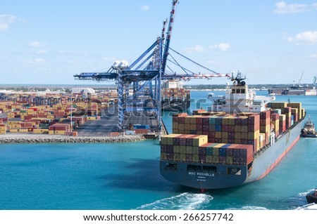 PORT OF FREEPORT GRAND BAHAMAS ISLAND - JAN., 18, 2015: MSC Rochelle pulling in to off and on load shipping containers - stock photo